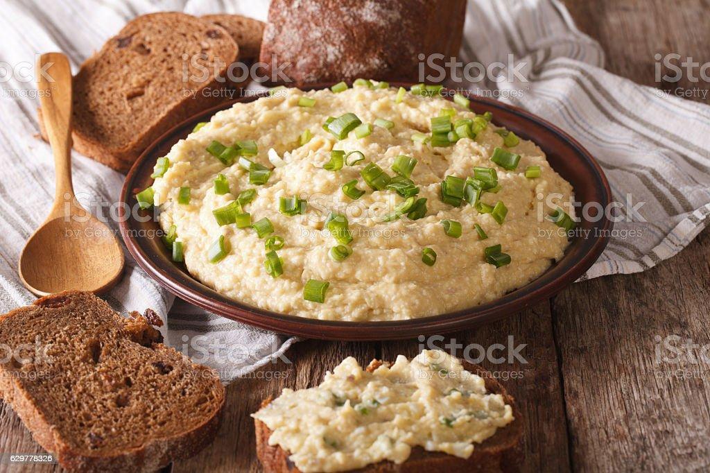 Jewish forshmak with rye bread close-up. Horizontal stock photo