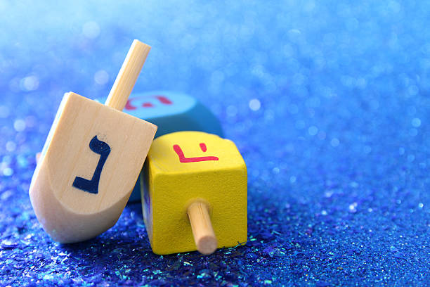 jewish hanukkah with wooden dreidel (spinning top) - hanoukka photos et images de collection