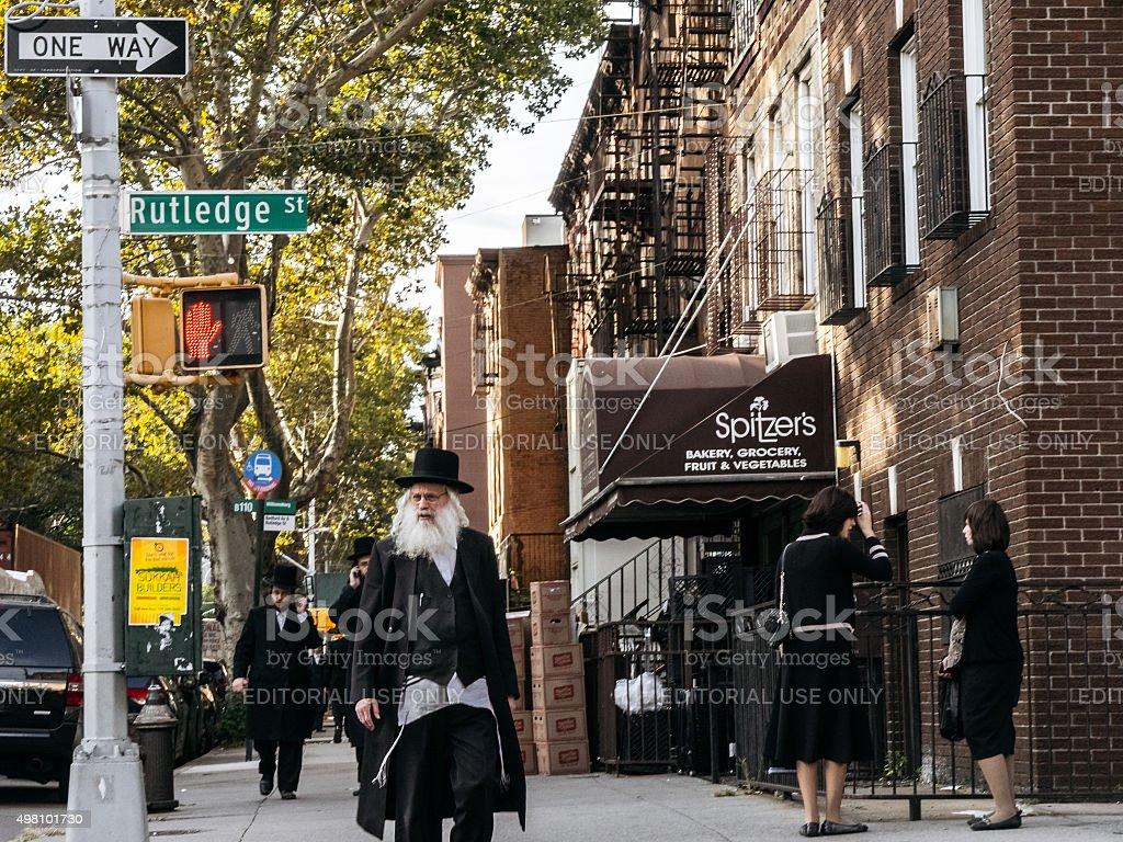 Jewish hassidic man crosses the street. stock photo