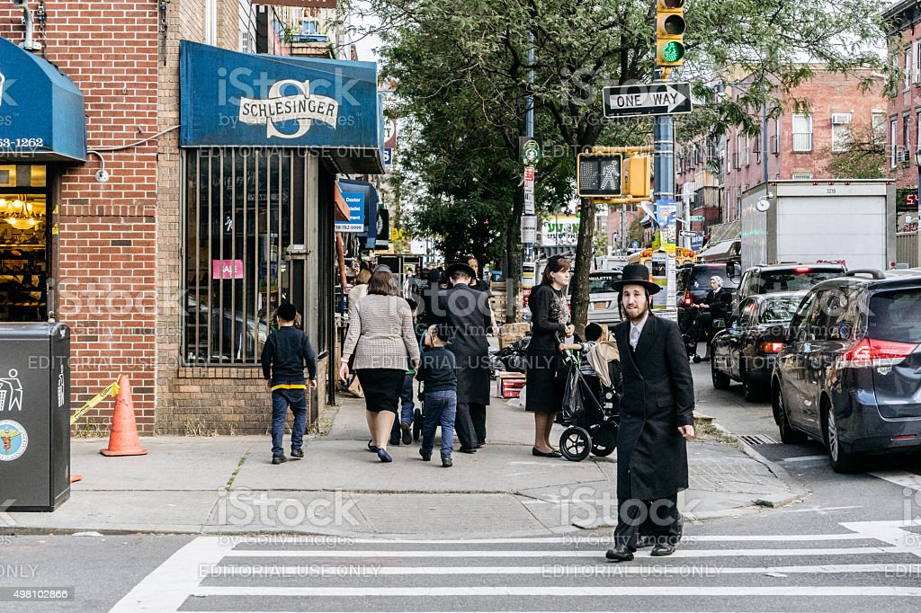 Jewish hassidic man crosses the street. stock photo