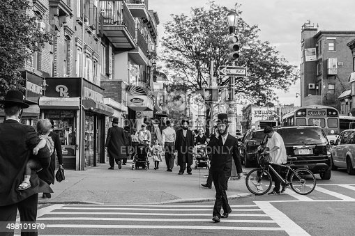 New York, USA - September 22, 2015: Jewish hassidic men cross the street.