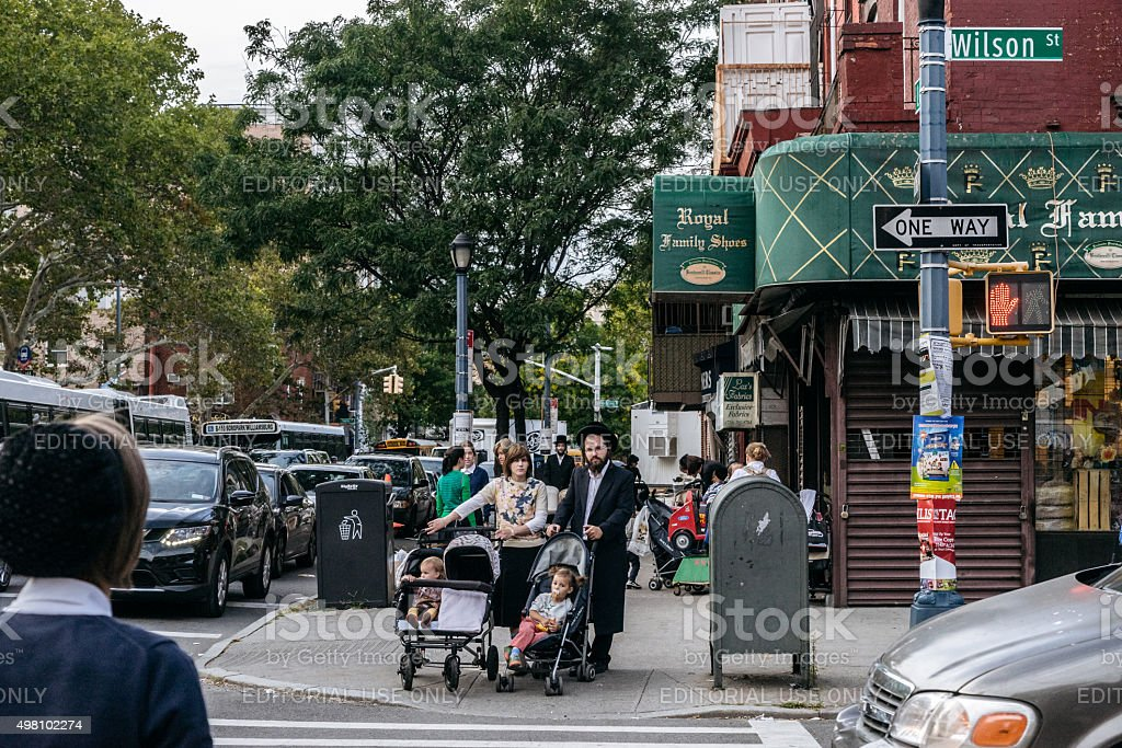 Jewish hassidic pair cross the street. stock photo