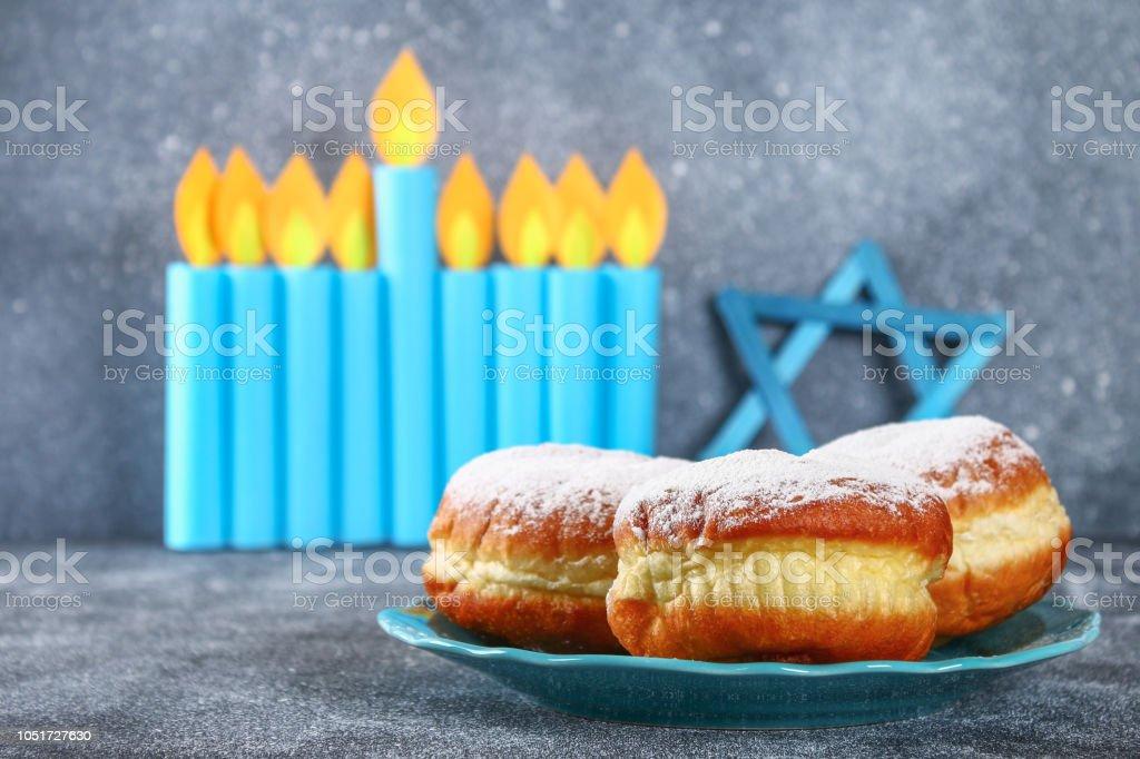 Jewish holiday Hanukkah and its attributes, menorah, donuts, Star of...