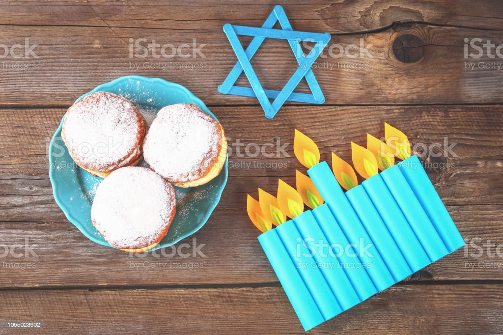 Jewish holiday Hanukkah and its attributes, menorah, donuts, Star of...