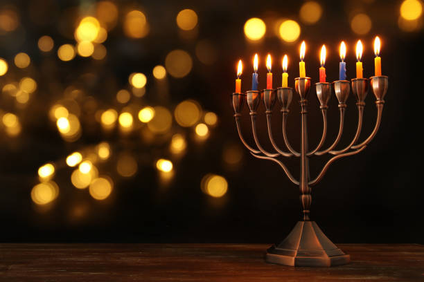 jewish holiday Hanukkah background with menorah (traditional candelabra) and burning candles stock photo