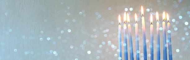 jewish holiday hanukkah background with menorah - hanukkah stock photos and pictures