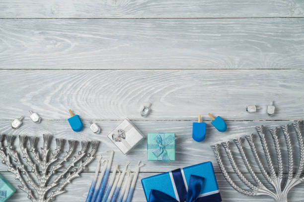 jewish holiday hanukkah background with menorah, spinning top and gift box on wooden table - hanukkah stock pictures, royalty-free photos & images