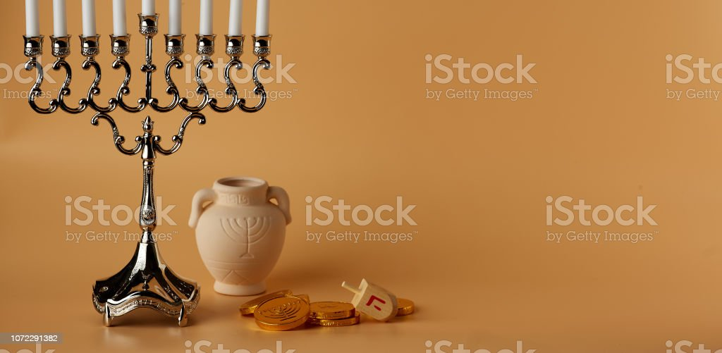 Jewish holiday Hanukkah background with menorah, spinning top, coins...