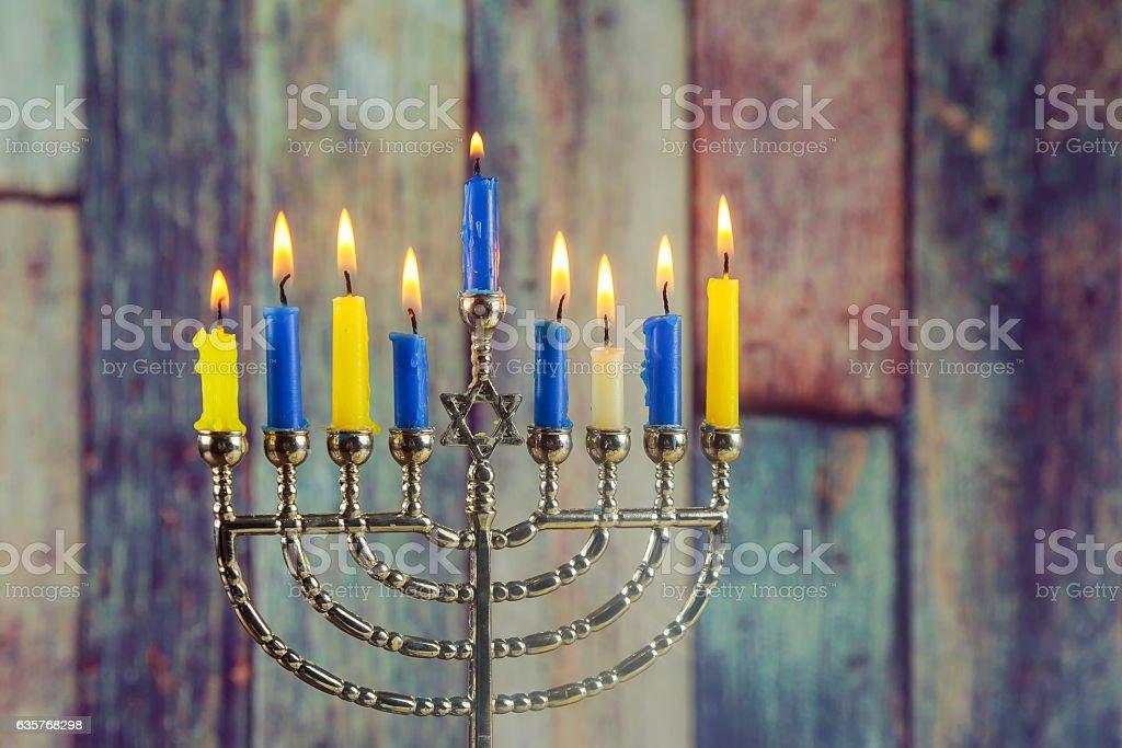 jewish holiday Hanukkah background with menorah traditional candelabra stock photo