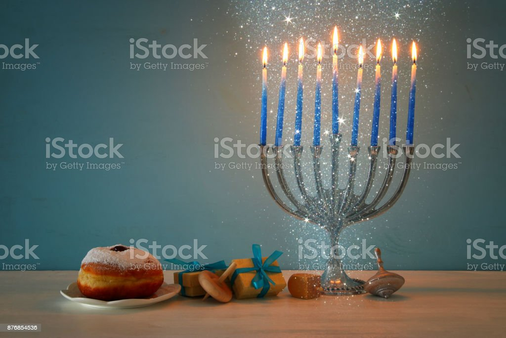 mage of jewish holiday Hanukkah background with traditional spinnig...