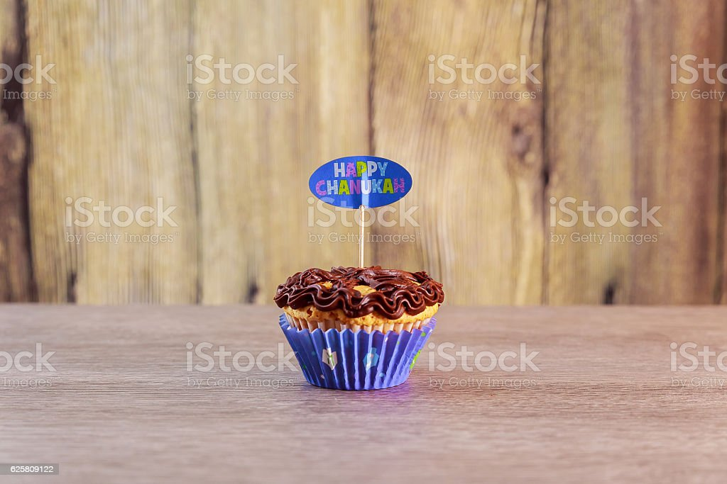 Jewish holiday Hanukkah cupcakes decorated with white and blue . stock photo