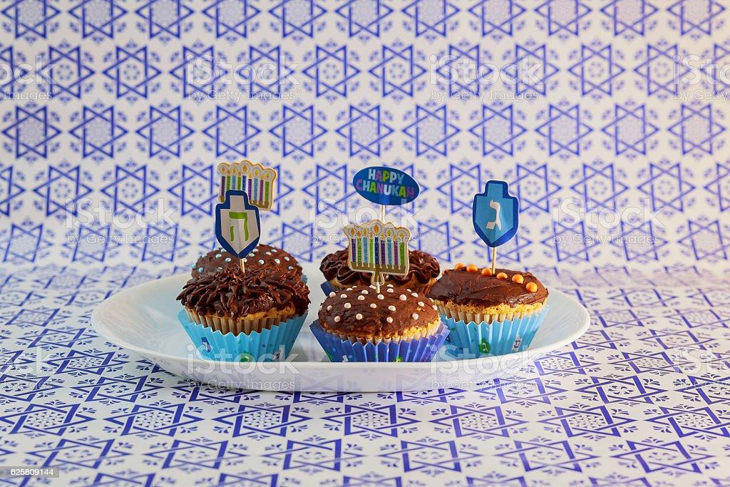 Jewish holiday Hanukkah cupcake Gourmet cupcakes decorated with white...