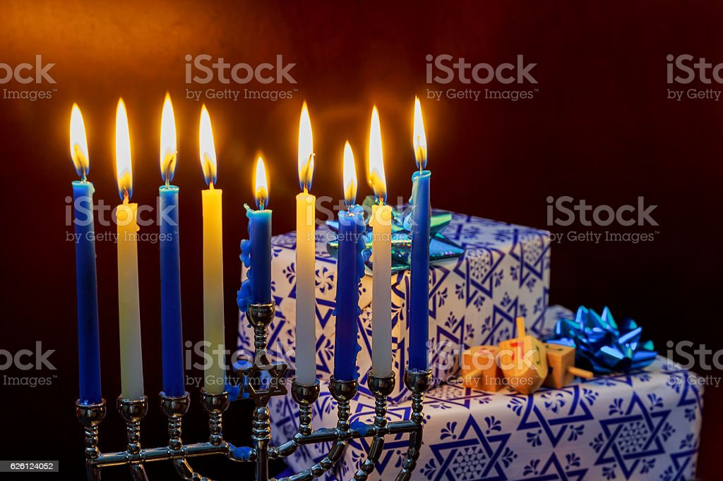 Jewish Holiday Hanukkah holiday with menorah burning candles. stock photo