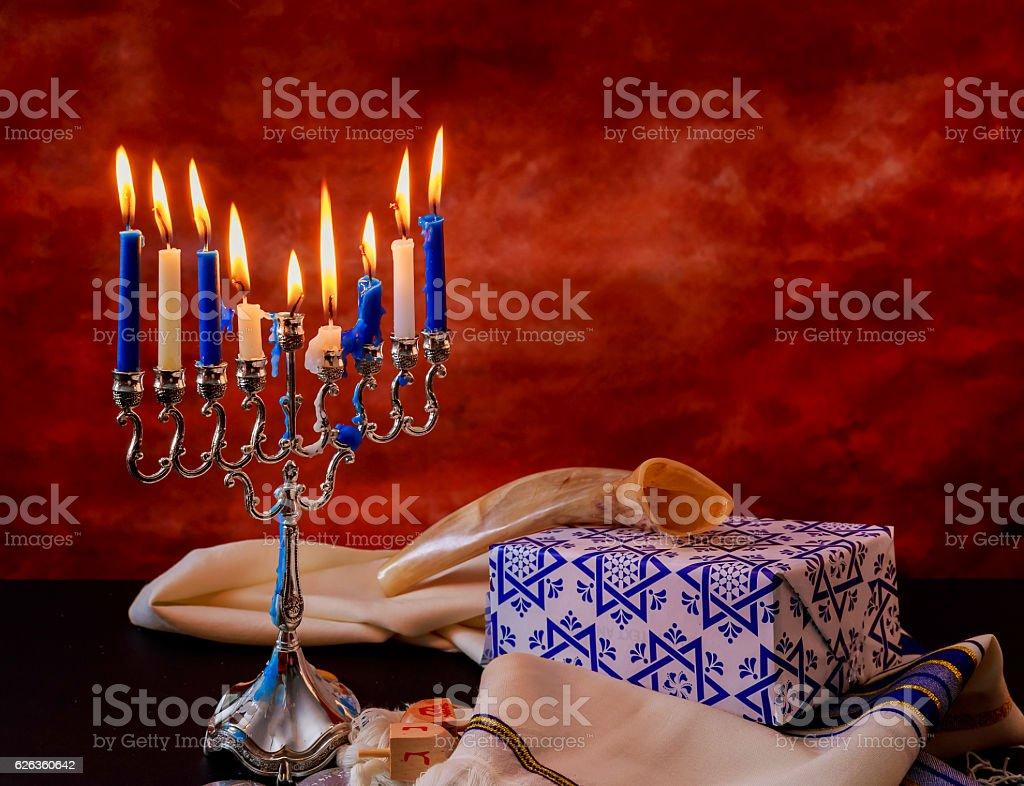 Jewish holiday Hanukkah creative background with menorah. View from...