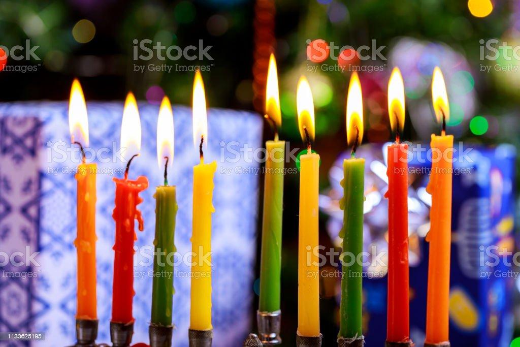 Jewish holiday Hanukkah with menorah traditional candelabra burning...