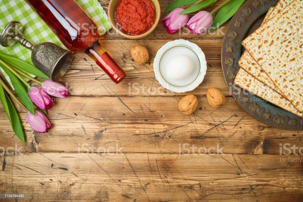Jewish Holiday Passover Background With Matzo Seder Plate Wine And Tulip Flowers On Wooden Table Stock Photo Download Image Now Istock
