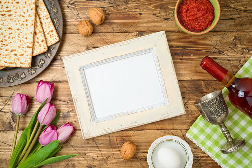 Jewish Holiday Passover Background With Matzo Seder Plate Wine Tulip Flowers And Photo Frame On Wooden Table Stock Photo Download Image Now Istock