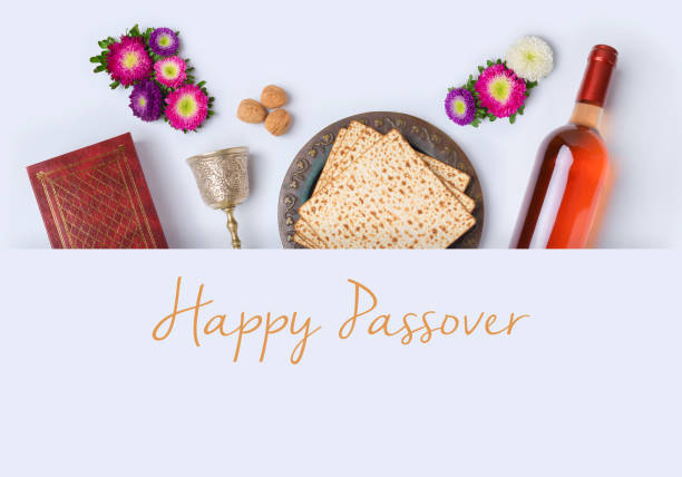 Jewish holiday Passover banner design Jewish holiday Passover banner design with wine, matzo and seder plate on white background. View from above. Flat lay passover stock pictures, royalty-free photos & images