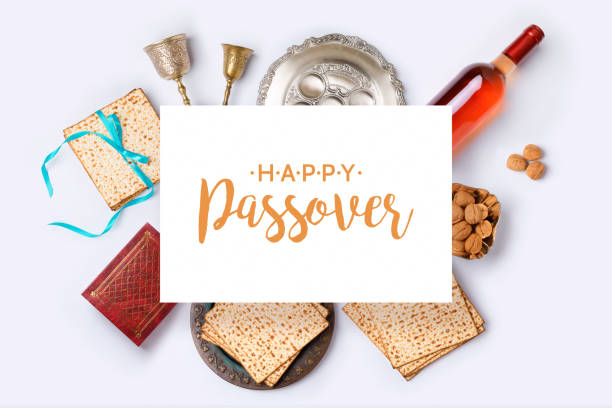 Jewish holiday Passover banner design Jewish holiday Passover banner design with wine, matza and seder plate on white background. View from above. Flat lay passover stock pictures, royalty-free photos & images