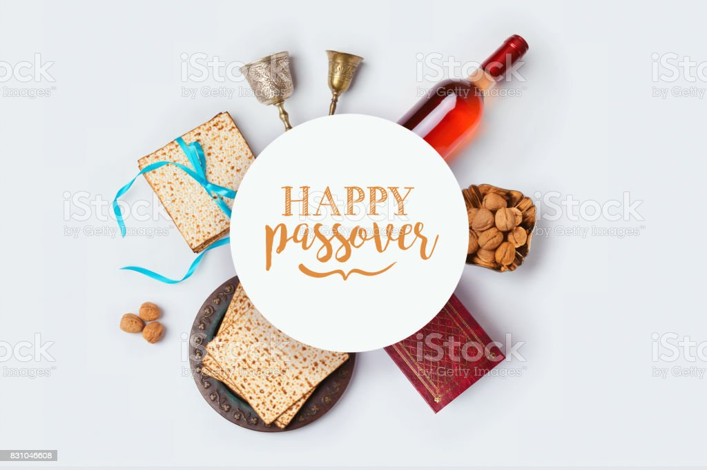 Jewish holiday Passover banner design with wine, matza and seder plate on white background. View from above. Flat lay stock photo