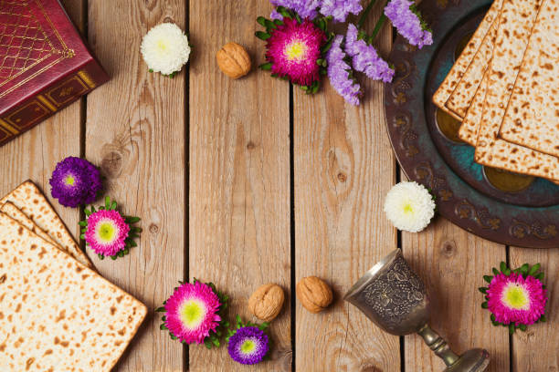 jewish holiday passover concept with matza and seder plate over wooden background. view from above - passover stock photos and pictures