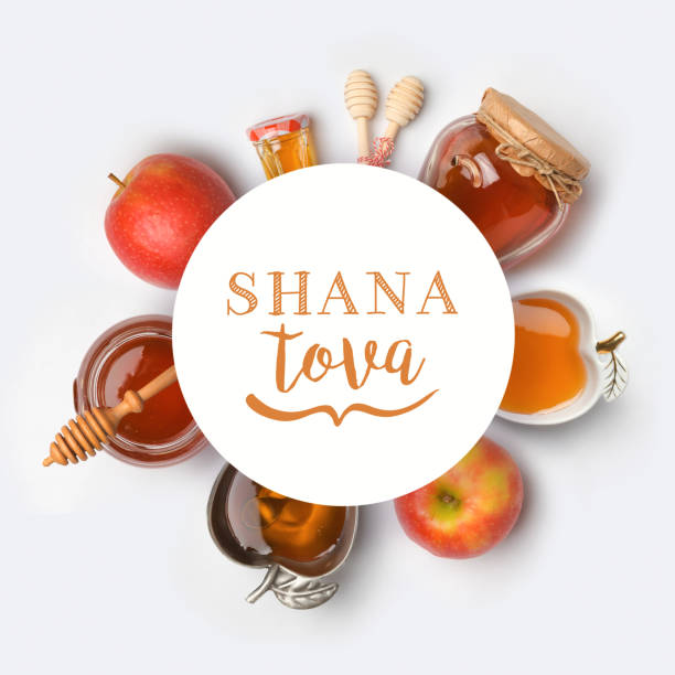 Jewish holiday Rosh Hashana banner design Jewish holiday Rosh Hashana banner design with honey and apples. View from above. Flat lay rosh hashanah stock pictures, royalty-free photos & images
