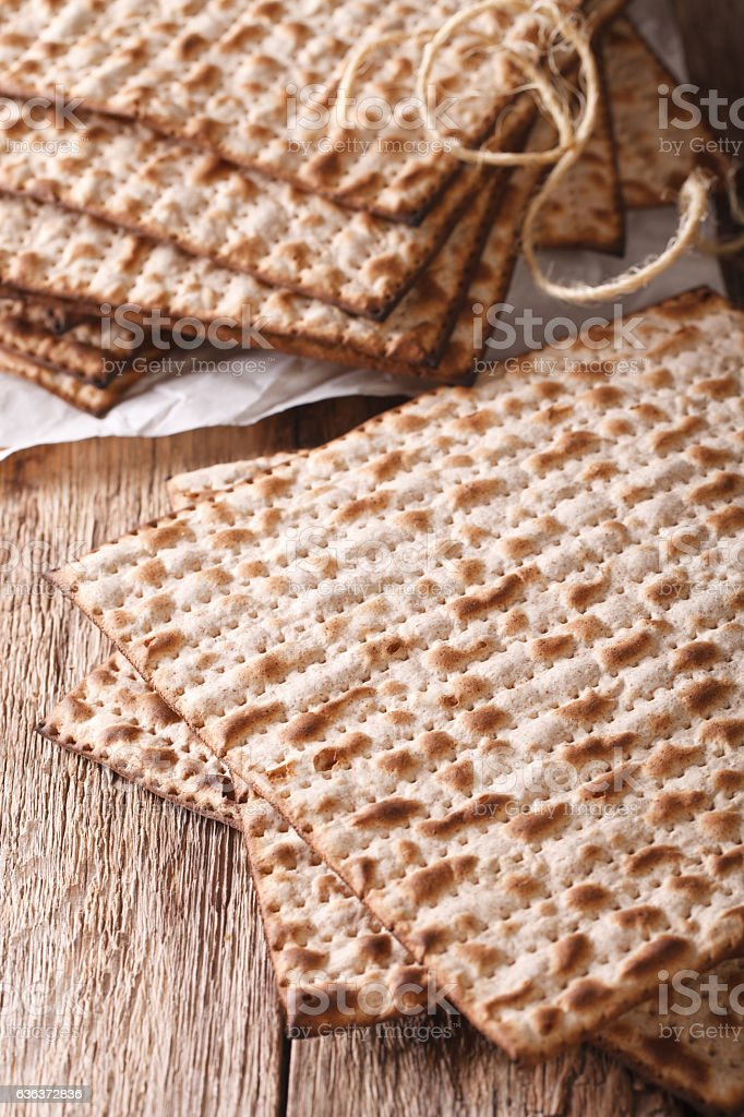 Jewish kosher matzah macro on a table. Vertical stock photo