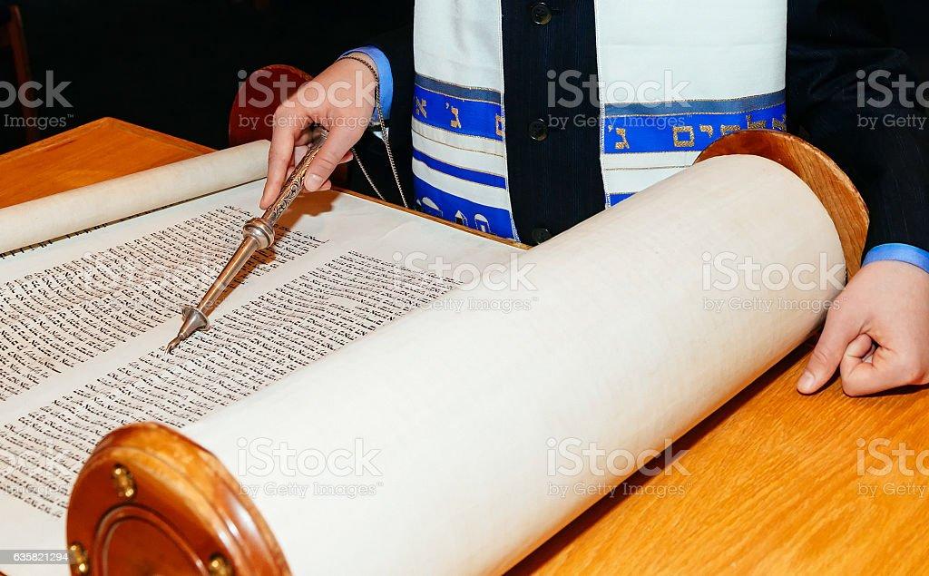 Jewish man dressed in ritual clothing Torah at Bar Mitzvah - Photo