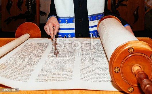 Jewish man dressed in ritual clothing 5 SEPTEMBER 2015 USA NY Hand of boy reading the Jewish Torah at Bar Mitzvah Bar Mitzvah Torah reading