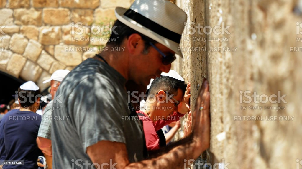 Jewish man pray at the Western Wall in Jerusalem stock photo