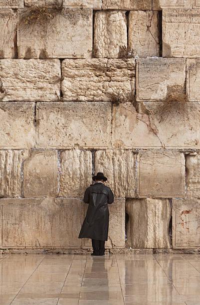 Jewish man praying on the Wailing Wall in Jerusalem stock photo