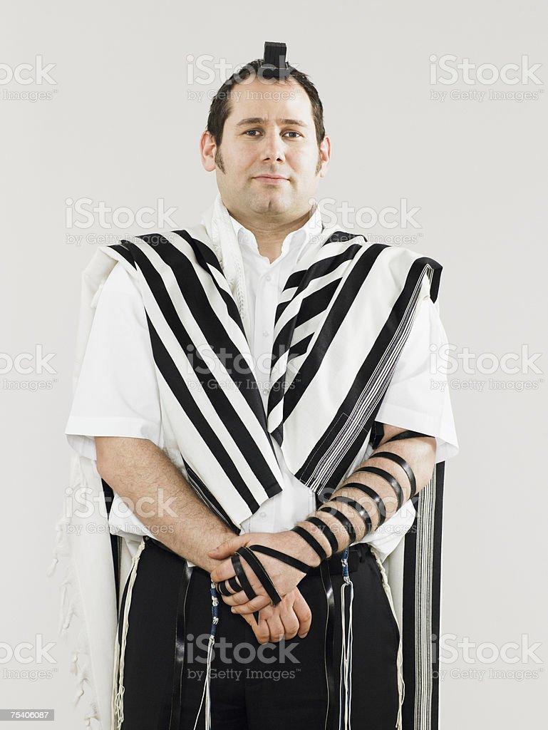 Jewish man wearing tallit and teffillin for prayers stock photo