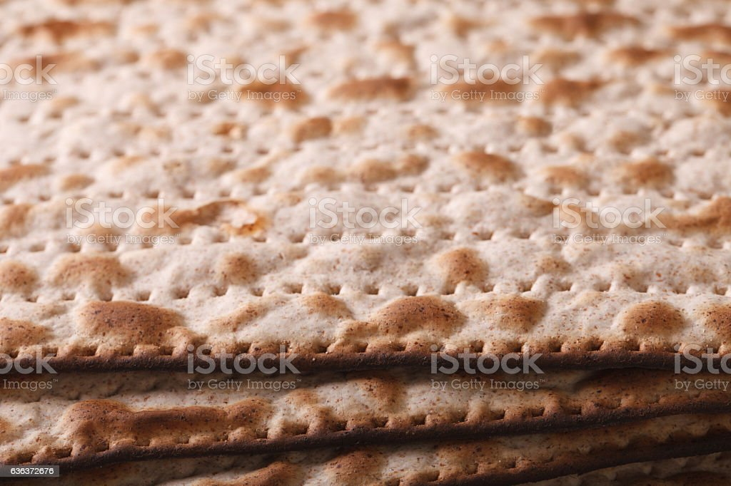Jewish matzo Flatbread texture close-up, horizontal stock photo