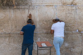 Jewish men praying at the Western Wall, important Jewish religious site in the Old City of Jerusalem, Israel: October 24, 2018.