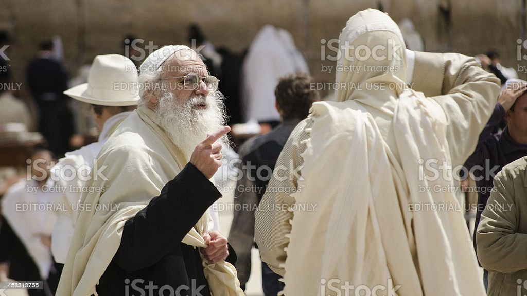 Jewish old men at the Western Wall in Jerusalem royalty-free stock photo