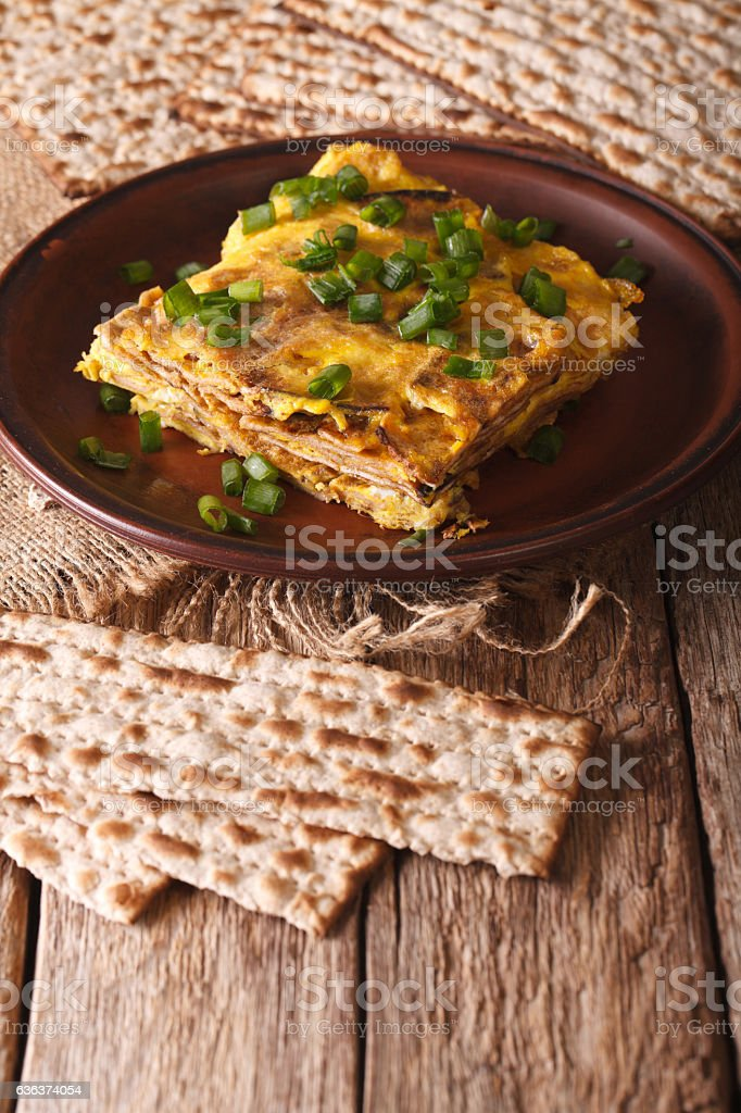 Jewish omelette: matzah brei with green onions close-up. Vertical stock photo