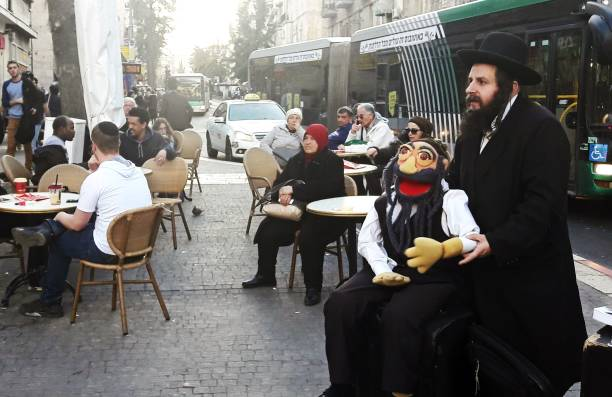 A Jewish Rabbi being a funny street performer. stock photo