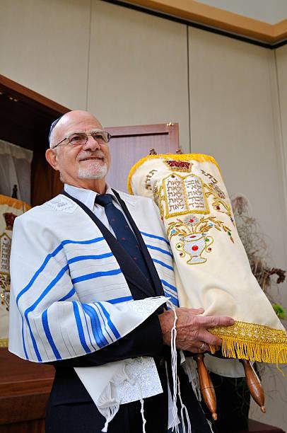 jewish rabbi holds torah - mike cherim stock pictures, royalty-free photos & images
