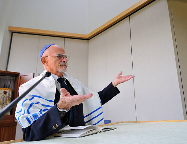 jewish rabbi says 'please rise' - mike cherim stock pictures, royalty-free photos & images