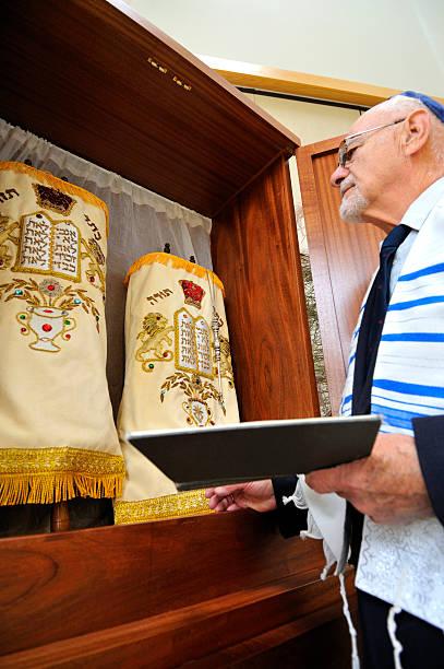 jewish rabbi with torahs - mike cherim stock pictures, royalty-free photos & images