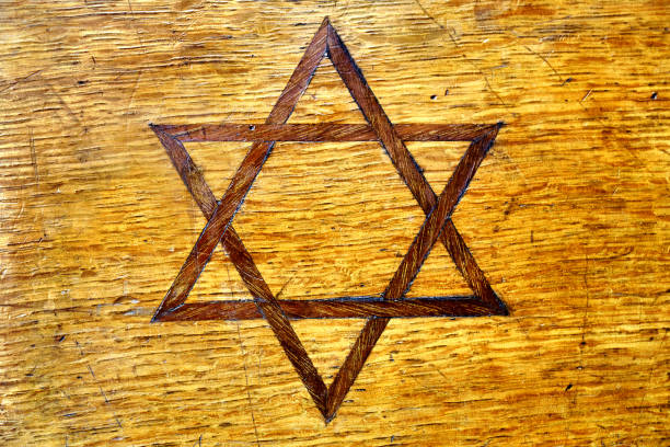 Jewish symbol star of David inlayed on vintage wooden casket side Jewish symbol star of David inlayed on shabby vintage wooden casket side inlay stock pictures, royalty-free photos & images
