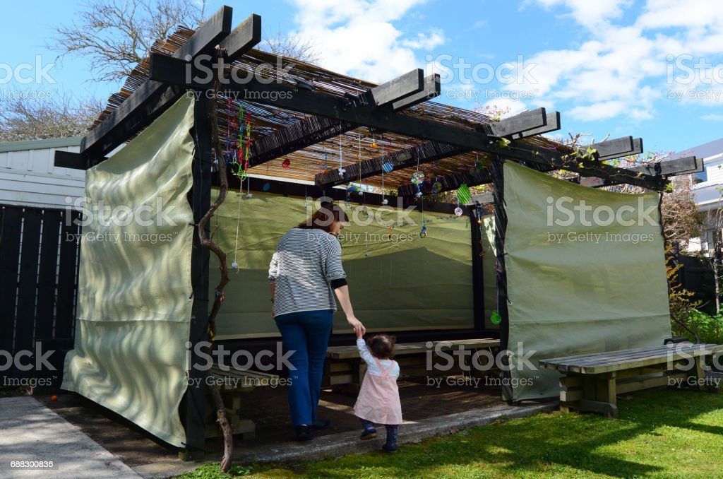 Jewish woman and child visiting their family Sukkah stock photo