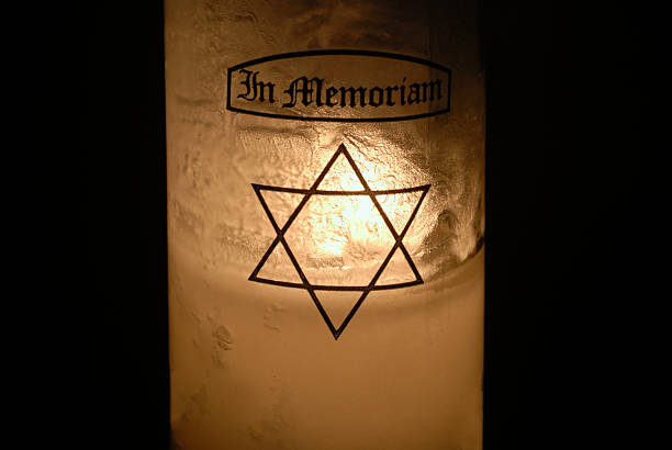 Jewish Yahrzeit Candle to Remember the Dead stock photo