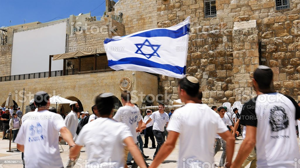 Jews dancing in a round with flag in Jerusalem stock photo