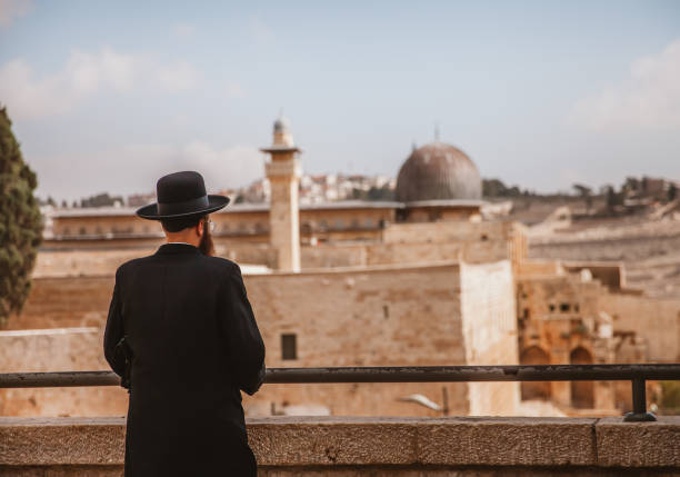 Jews Looking at the Dome of Rock in Jerusalem Jerusalem,Israel - November 1st,2016: A rabbi is looking at the Dome of Rock in Jerusalem.The old city of Jerusalem can be seen in th epicture. jerusalem old city stock pictures, royalty-free photos & images