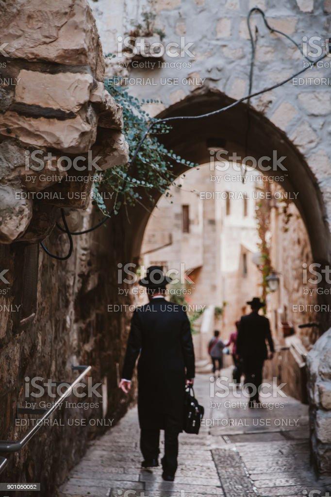 Jews Walking in Jerusalem stock photo