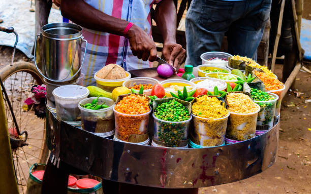 Jhal Muri Stall Seller selling on of the famous Indian and Bengali street food made by puffed rice and various ingredients called Jhal Muri asian market stock pictures, royalty-free photos & images