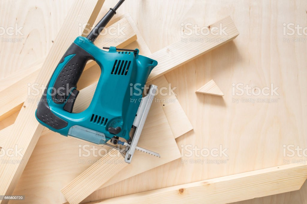 Jig saw on Wooden Background stock photo