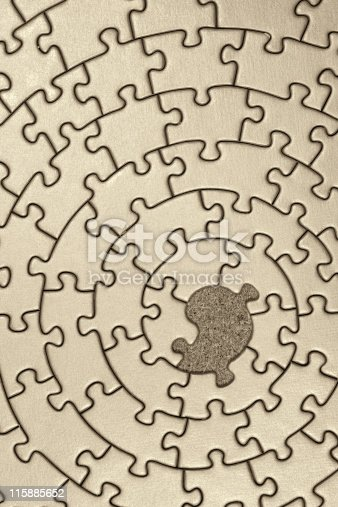 istock jigsaw in sepia with one missing piece 115885652
