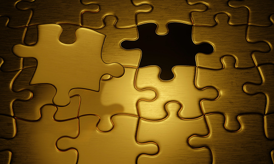 688372024 istock photo Jigsaw or puzzle, dark metal surface. Gold color blocks for a perfect complement. Bright white background from the bottom. 3D Rendering 1262354297